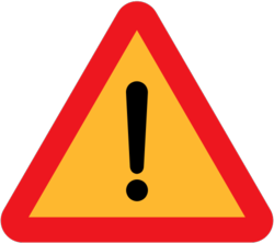 513px-Road-sign-Other-dangers.svg