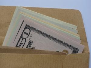 Brown-envelope-money-bribe-1-1384588-m